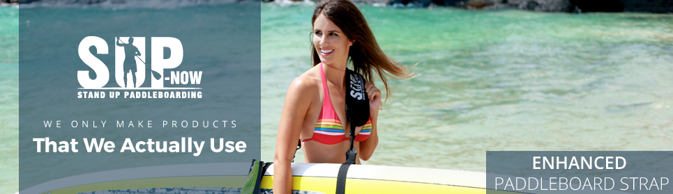 SUP-now's enhanced paddle board strap that helps you carry your paddle board and your paddle.