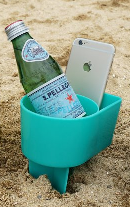 A cup holder that digs right into the sand to keep your drinks sand-free. It's a must have beach accessory for the summer.